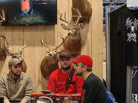 In this file photo, pro staff members of Palmyra's Bow Creek Outdoors prepare for another busy day in the archery hall at the NRA Great American Outdoor Show in Harrisburg.