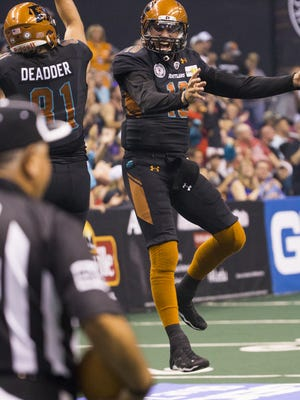 Rattlers quarterback Nick Davila and Chase Deadder (81) celebrate a touchdown against the Steel at Talking Stick Resort Arena on June 11, 2016, in Phoenix.