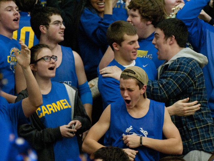 Carmel fans celebrate after defeating host Hamilton Southeastern, 55-54, on Thursday, Feb. 13, 2014.