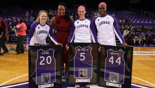Carolina Day alum Allison Beasley (5) is a senior guard for the Furman women's basketball team.