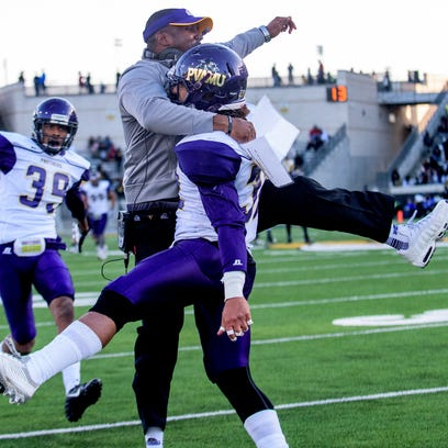 Prairie View coach Willie Simmons celebrates with Marquice