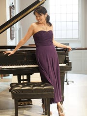 Pianist Hiroko Yamazaki wears a purple strapless silk Ralph Lauren dress she bought on eBay and silver Aerosoles sandals she bought because she likes the tassel detail.