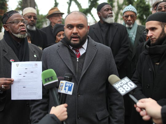 Multiple civil rights groups held a press conference outside One Police Plaza in Manhattan on Tuesday.  They announced multiple lawsuits against the New York Police Department.  One lawsuit by Paramus resident, Samir Hashmi (shown here), who was surveilled while a student at Rutgers University, involved in the Muslim Student Association has requested documents linked with that surveillance but has been denied. Tuesday, November 26, 2013.
