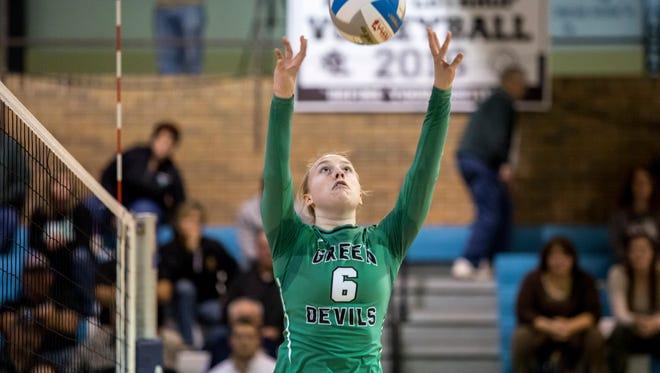 Brown City senior Alexia Mason sets the ball during a Class C regional volleyball game Thursday, Nov. 10, 2016 at Flint Hamady High School.