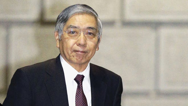 Governor of the Bank of Japan Haruhiko Kuroda arrives at its head office in Tokyo Jan. 29, 2016.