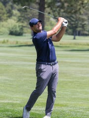 Tony Romo hits a shot on the 14th hole during the American Century Championship at Edgewood Tahoe Golf Course in Stateline on Sunday.