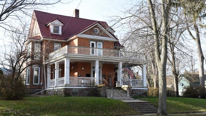 The 6,000 square foot Colonial revival Dave and Brittany Rademacher of Grand Ledge are renovating in downtown Grand Ledge.  It was built in 1873.