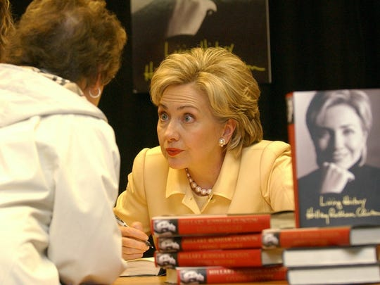 "Sen. Hillary Clinton autographs copies of ""Living History"""