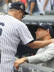 Former Yankee manager Joe Torre with catcher Gary Sanchez in the dug out before the start of today's game against the Blue Jays.