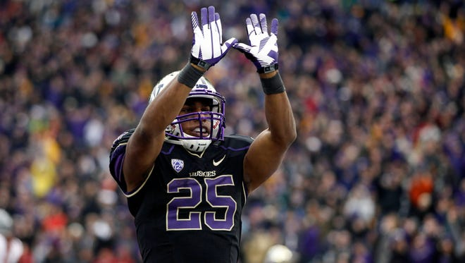 Washington Huskies running back Bishop Sankey (25) celebrates after rushing for a touchdown against the Washington State Cougars during the third quarter at Husky Stadium. The touchdown by Sankey set a new personal career record for rushing touchdowns at Washington.