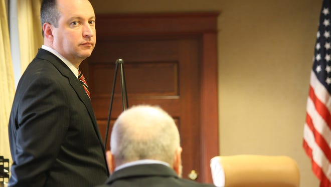 Assistant Butler County Prosecutor Brad Burress looks past defendant Daniel French into the courtroom Monday during opening statements of French's death-penalty trial.