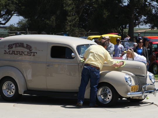 Gary and Terri Calvert polish up the Posse Pick Award — the actual Star Market truck used for years to deliver groceries.