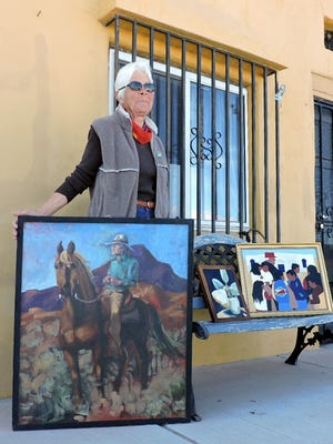 Helena Myers shows a sample of the artwork that will be on display at the Old Customs House at Pancho Villa State Park in Columbus. Works by 20 local artists will include paintings, textiles, drawings and assemblages  The show will take place from 9:30 a.m. to 4:30 p.m. on Saturday in conjunction with the activities commemorating the 100th anniversary of the Pancho Villa raid on Columbus. The park is located at the junction of NM highways 11 and 9, 30 miles south of Deming.