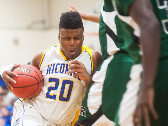 Wicomico guard Nelson Brown (20) drives to the basket