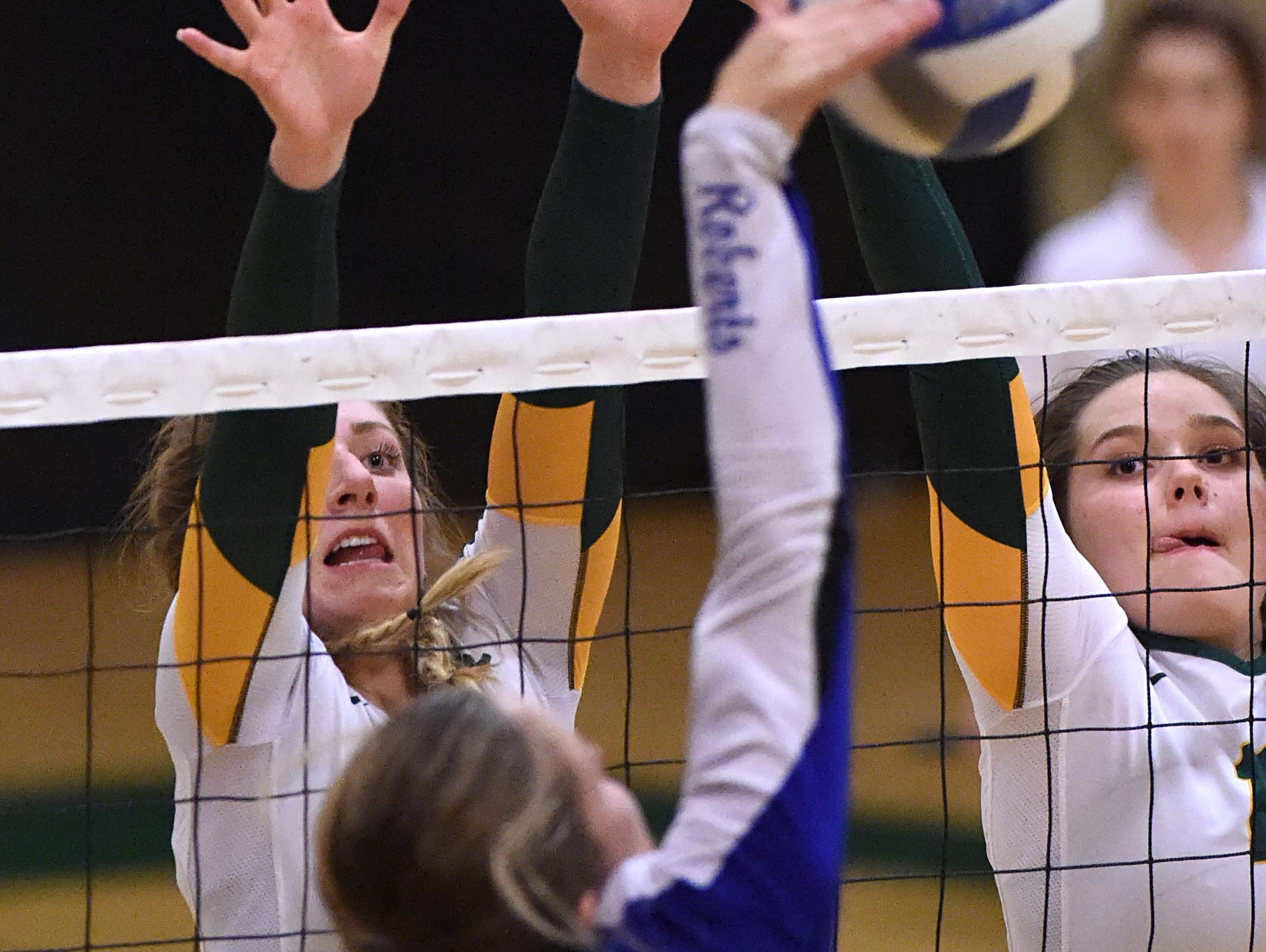 Bishop Manogue's Becca Smith, left, and Sara Pool go up to block a shot by Carson's Jaycie Roberts during Tuesday's game at Bishop Manogue High School on Oct. 18, 2106.