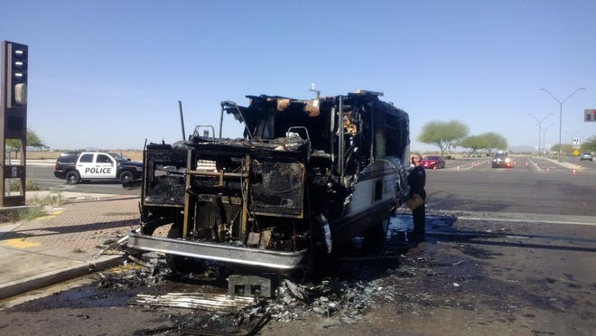 A 57-year-old man suffered second-degree hand burns Sunday after his motor home caught fire, blocking a major Goodyear intersection.