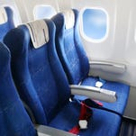 You board a plane and find your seat stained with bodily fluids. Now what?