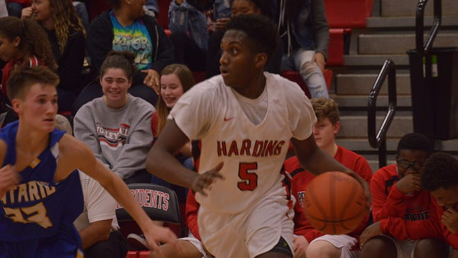 Harding's Deante Smith drives to the basket against Ontario. The Presidents earned their first win of the season with a 52-45 win over Galion.