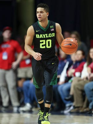 Baylor guard Manu Lecomte (20) brings the ball up the court during the first half against Mississippi.
