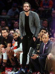 New York Knicks injured center Joakim Noah (13) watches from the bench during the fourth quarter against the Los Angeles Lakers at Madison Square Garden.