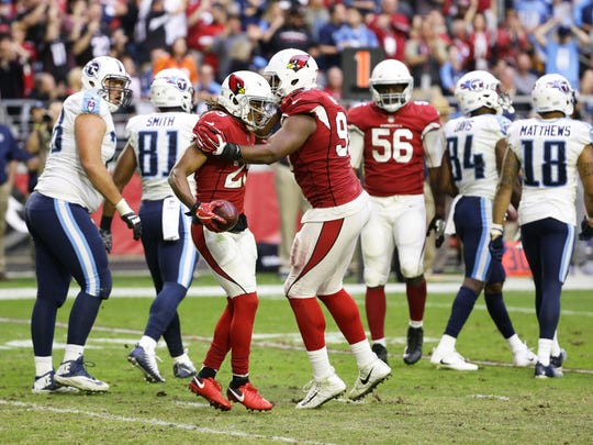 Cardinals cornerback Tramon Williams (left) celebrates