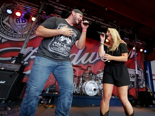 Members of the band Road Crew perform at the Bud Light music pavilion during the opening day of the Wisconsin State fair at State Fair Park in West Allis on Thursday, August 4, 2016.