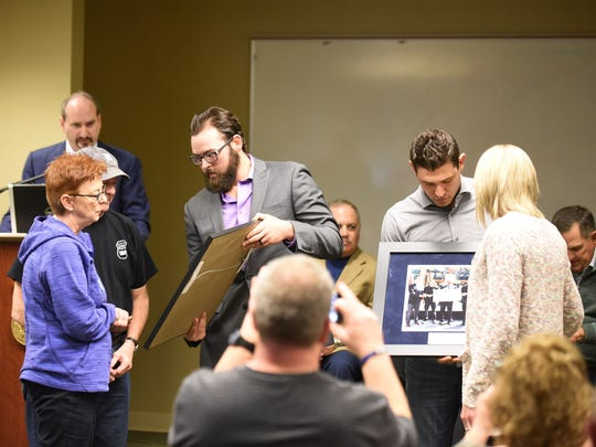 The Tigers' Michael Fulmer, left, presents parents, Karen and Randy Rose, and Ian Kinsler presents Nikki Salgot of St. Clair Shores, fiancee of Sgt. Collin Rose, with pictures from the Tigers on Friday.