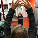 Melissa Ontiveros-Chavez trains with help from physical therapist Sandra Terrazas at Spectrum Fitness.