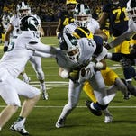 Jalen Watts-Jackson (20) dives into the end zone for the game-winning touchdown.