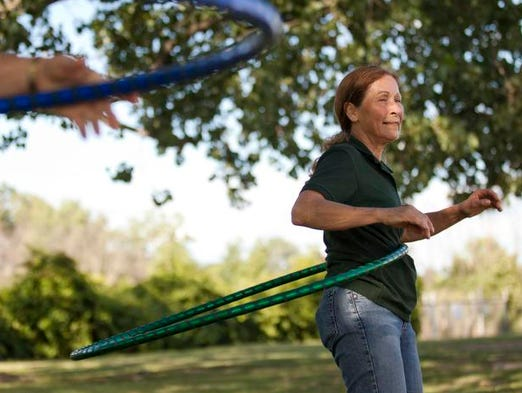 Charlotte Godfrey of Goodells hula hoops during a beginning hula hoop class August 14, 2014 at Buff Bodies Boot Camp in Marysville.