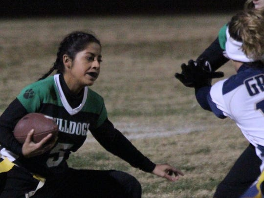 The Lady Bulldogs defeated Cheyenne, 13-6, Monday night in North Las Vegas and followed that up with a convincing 33-13 triumph over Sierra Vista Wednesday night in Las Vegas. Virgin Valley running back Elizabeth DeLeon looks for an opening against Spring Valley.