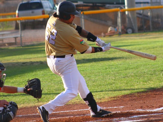 Kenny Chavez hits a double to left field during the