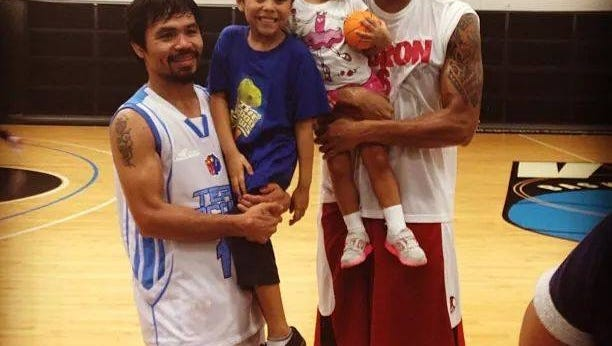 Joe Devance, right, poses with the world champion boxer Manny Pacquiao.