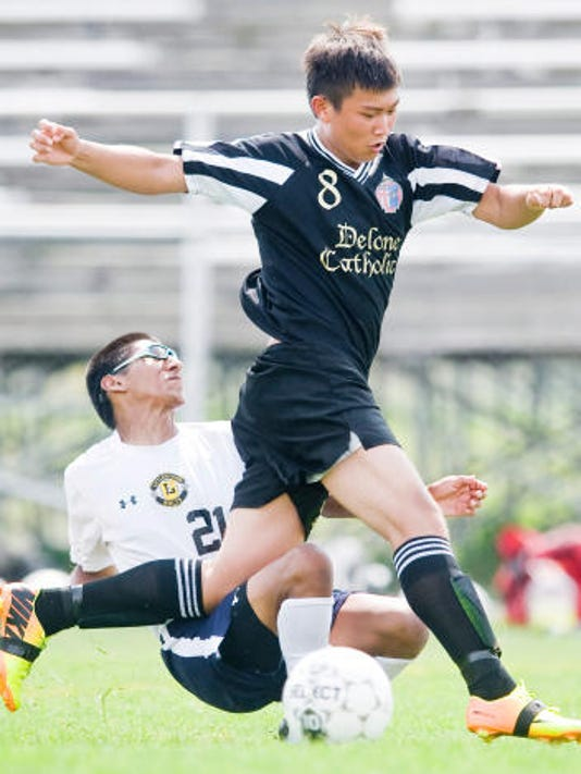 Delone Catholic's Niquinn Aquino, right, maneuvers around Littlestown's Jonathan Shorb during Saturday's game. Delone scored twice in the final minutes to beat the Bolts, 4-3. (The Evening Sun -- Jeff Lautenberger)