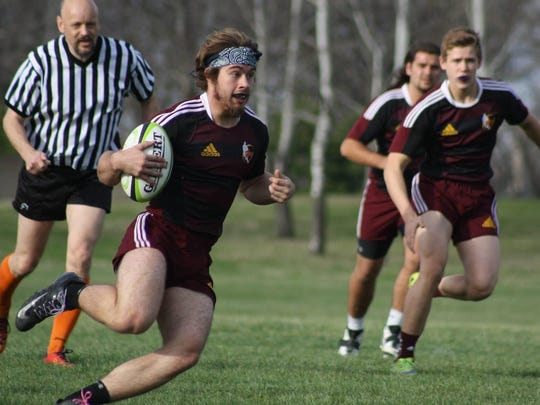 Ankeny's Colby Baugher carries the ball in a 2016 game against Mason City. Baugher and fellow 2018 Iowa Elite Team selection, Hunter Staab, return for the Hawks' rugby team this season.