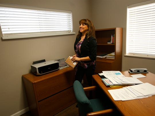Christine Garcia, outgoing CEO of Big Brothers Big Sisters of San Juan County, walks through her old office on Friday at the nonprofit organization's headquarters in Farmington.