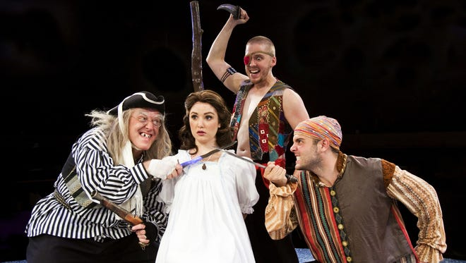 PHOTO COURTESY OF DERBY DINNER PLAYHOUSE Wendy, played by Madeline Perrone, is captured by pirates in Derby Dinner Playhouse?s production of Peter Pan.