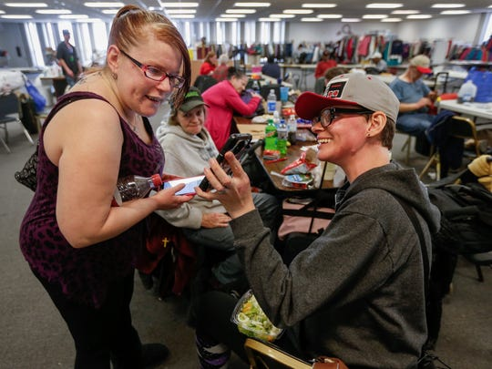 Mirenda Barrows, right, smiles as she shows Danika Sullens a picture of her son at the Veterans Coming Home Center on Thursday, Feb. 15, 2018. Barrows was pregnant when she was hit by a truck while crossing the street in June 2017. She suffered extensive injuries and lost her baby.