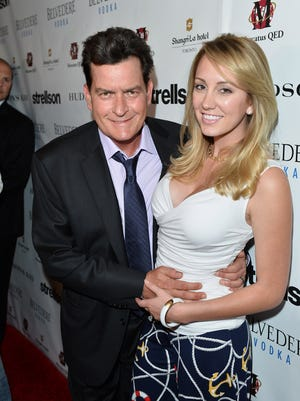 Charlie Sheen and ex-fiancée Scottine Sheen at an event in June 2014.