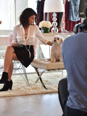 A behind-the-scenes look at Sarah Hyland and her dog on the set of the Candie's Fall 2016 campaign.