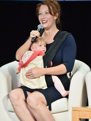 Women's March National Co-President Bob Bland speaks onstage while holding her child during Global Citizen: Movement Makers at NYU Skirball Center on September 19, 2017 in New York City.