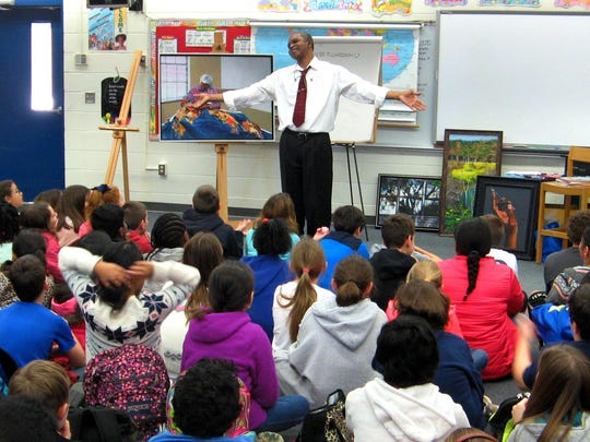 Eluster Richardson with Gilchrist fifth-graders.