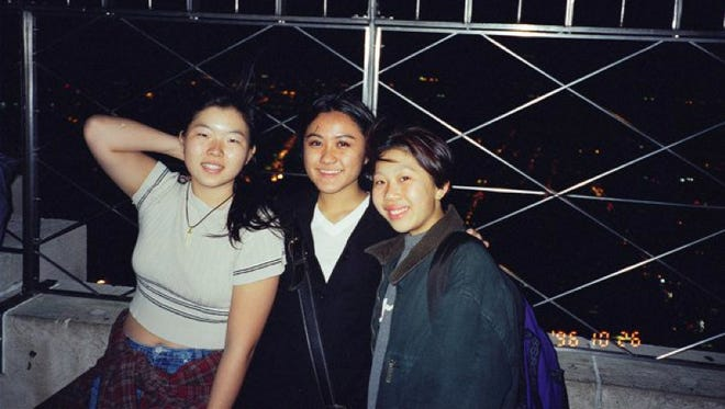 Friends, from left, Sue Lee, Anabela Mok Sreedharan Judy Lee smile together at the top of the Empire State Building in New York City, New York, in 1996.