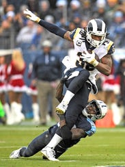 Titans cornerback Tye Smith (33) stops Rams running back Todd Gurley II (30) during the second quarter Sunday.