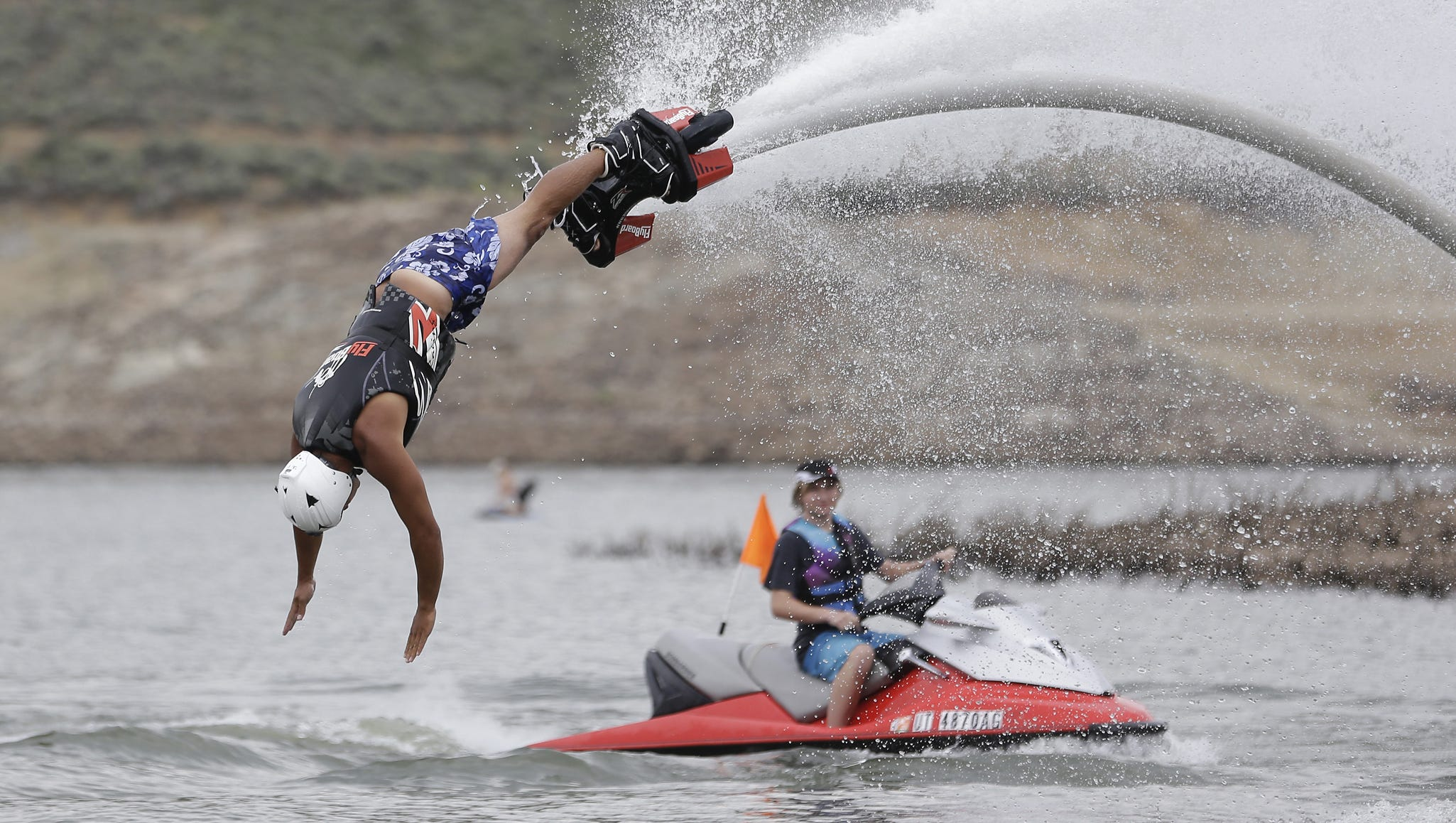 Jordan Wayment dives into the water as he demonstrates the flyboard.
