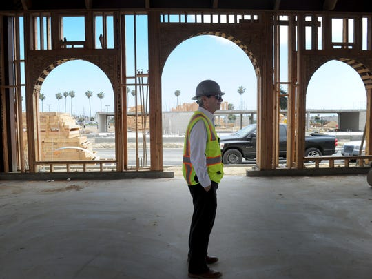 Michael Sondermann, manager of Sondermann Ring Partners LLC, checks out construction at Portside Ventura Harbor.