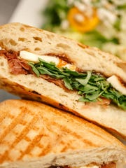 The prosciutto, Brie and fig jame panini at Postino.