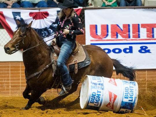 Tyra Kane clips the barrel during the SLE Rodeo matinee