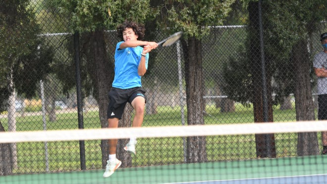 Pueblo West High School junior Tommy Cruz leaps to hit a backhand against Central's Luke Johnson during the Class 4A Region 7 No. 3 singles championship match. Cruz defeated Johnson 6-0, 6-0 to claim the region championship.
