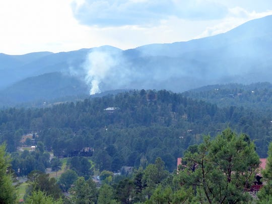 Firefighters have completed a fire line around the Mescalero fire that broke out Tuesday.
